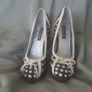 Black with white polka dot platform pumps.